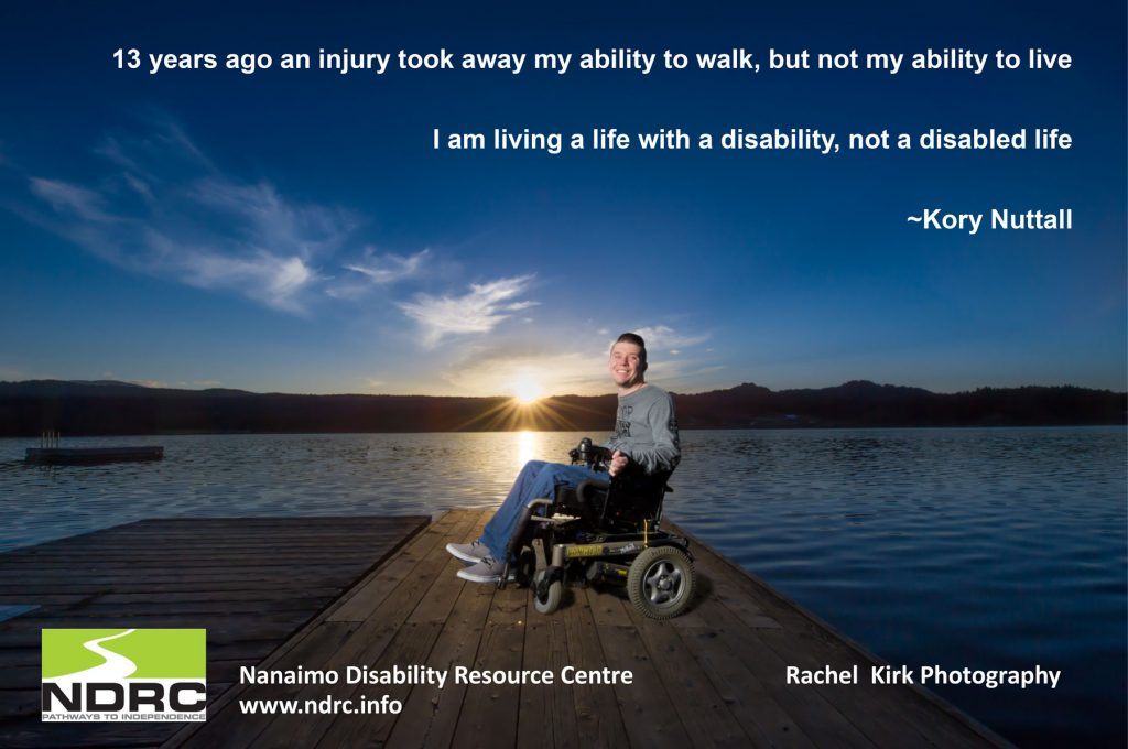 "A man in a wheelchair on a dock at sunset with the words ""13 years ago an injury took away my ability to walk, but not my ability to live. I am living a life with a disability, not a disabled life. - Kory Nuttall"""