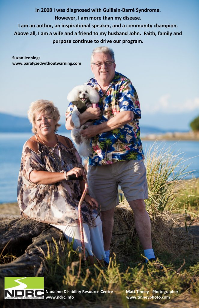 A man and a woman on an island, the man is holding a small dog, which tells the story of guillain-barre syndrome and how she's more than her condition