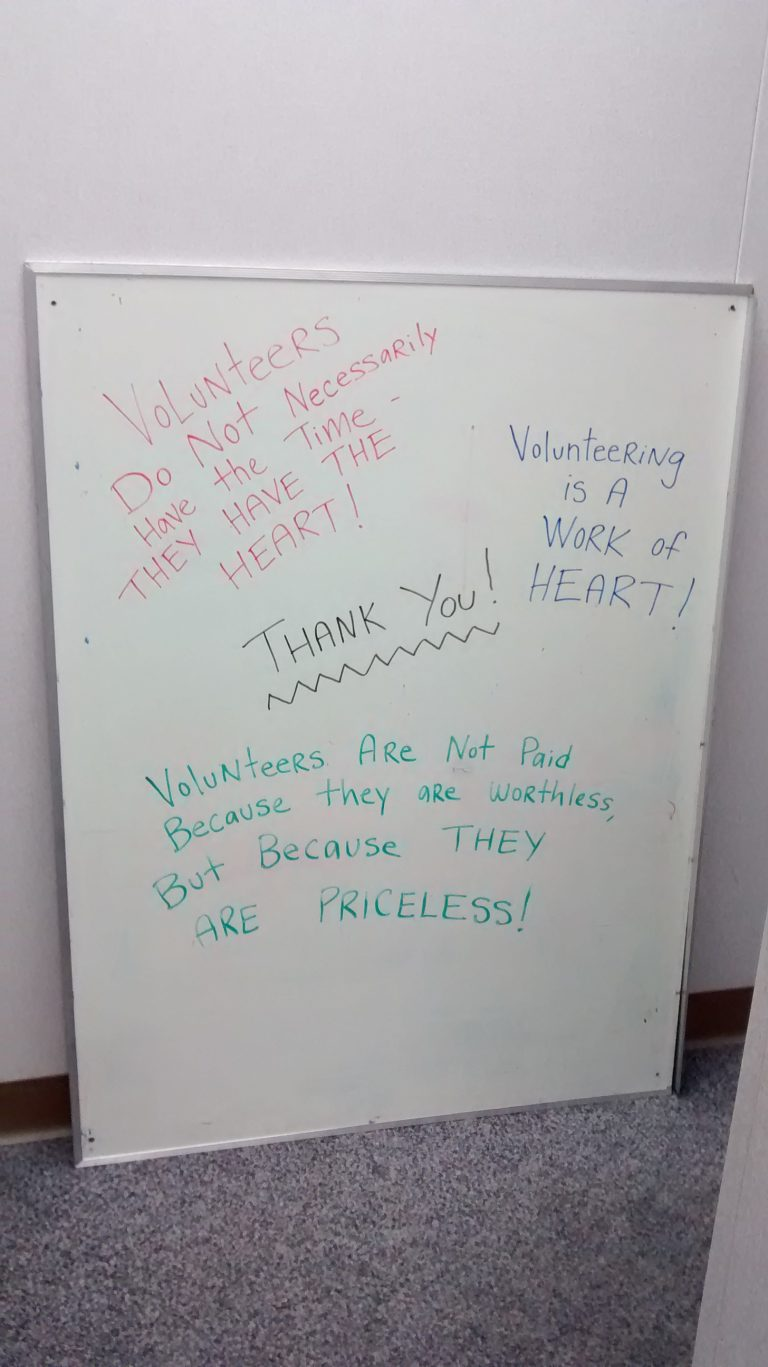 A white board with positive affirmations about volunteering coming from the heart