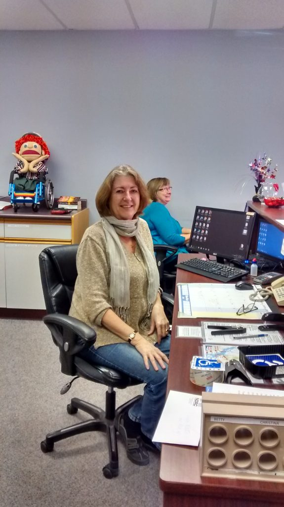 two women sit behind the front desk of NDRC