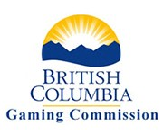 A yellow sun over blue mountains with British Columbia below it in blue with a yellow line below that. Gaming Commission is written beneath the line in blue.
