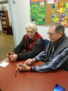 a volunteer and a student looking at a smart phone