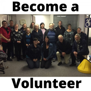 Become a volunteer with picture of volunteers and staff gathered
